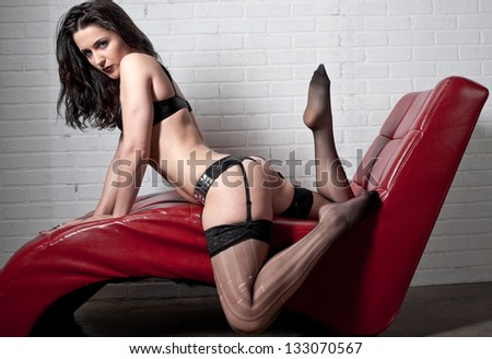 A sexy woman in black lingerie - stock photo