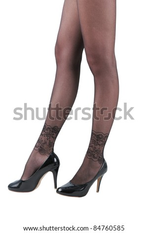 A sexy woman in legs high heels shoes and beautiful black stocking - stock photo