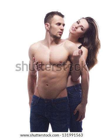 A sexy young topless couple embracing in jeans - stock photo