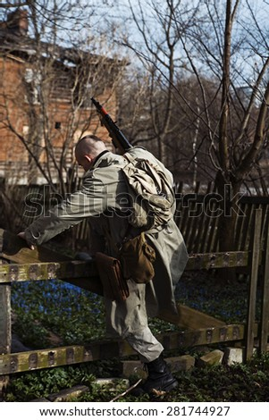A shaved hunter stepps over the fence - stock photo