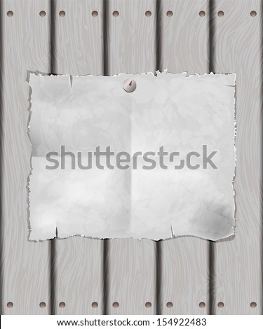 A sheet of white paper on a wooden surface,  paper is attached to the fence button, grunge background. Raster copy  - stock photo
