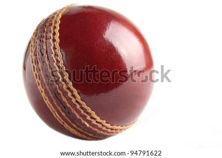 A shiny, new test match cricket ball, isolated on a white background. - stock photo