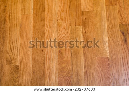 A shiny, polished hardwood floor for background or texture - stock photo