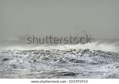 A ship in the ocean during stormy weather - stock photo
