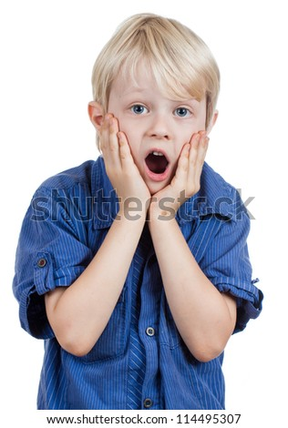 A shocked and surprised young boy looking at the camera. Isolated on white. - stock photo