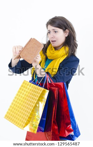 A shopaholic girl holding a empty wallet coming from shopping - stock photo