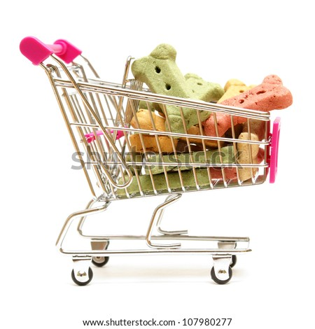 A shopping cart full of the pets favorite treat for when he is on good behavior. - stock photo