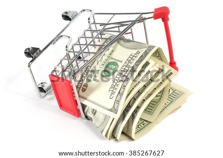 A shopping cart spilling one hundred US dollar bills, isolated on white background. - stock photo