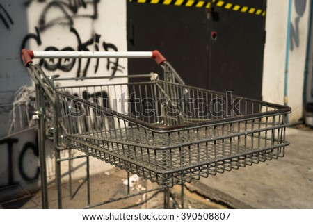 A shopping cart with street art background - stock photo