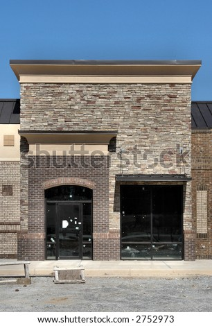 A shopping center storefront under construction, made to appear like a small town street. - stock photo