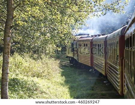 A shot looking from inside to train perspective in old retro noisy vintage style with smog and foggy background. Beautiful vintage conceptual photo of journey - stock photo