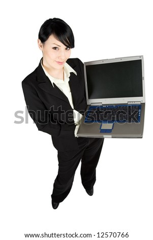 A shot of a beautiful businesswoman carrying a laptop - stock photo