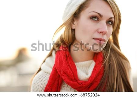 A shot of a beautiful caucasian winter woman outdoor - stock photo