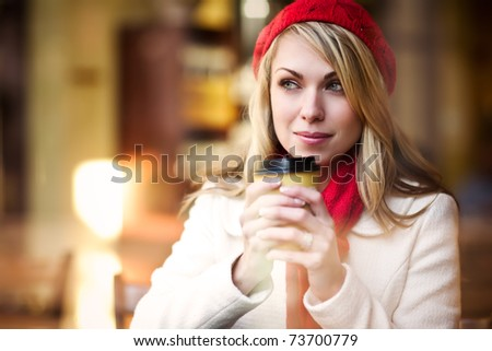 A shot of a beautiful caucasian woman drinking coffee at a cafe - stock photo