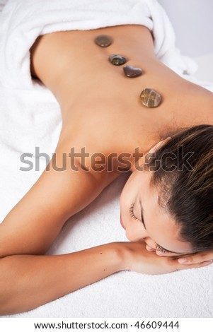 A shot of a black woman lying down at a spa - stock photo