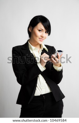 A shot of a businessman working on her PDA - stock photo