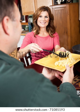 A shot of a caucasian couple having dinner at home - stock photo