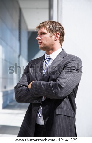 A shot of a confident caucasian businessman thinking - stock photo