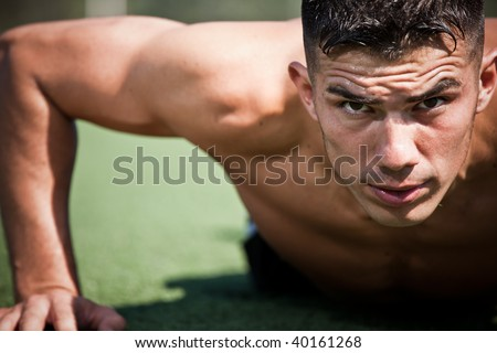 A shot of a hispanic athlete doing a push-up - stock photo