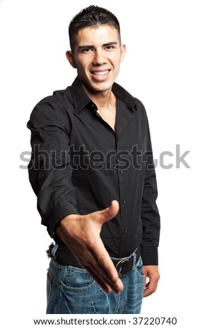 A shot of a hispanic businessman offering a handshake - stock photo