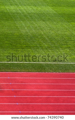 A shot of a running track & soccer field - stock photo