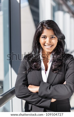 A shot of a smiling confident Asian Indian businesswoman outdoor - stock photo
