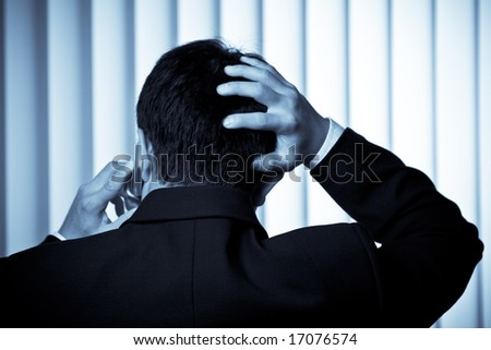 A shot of a stressed businessman talking on the phone - stock photo
