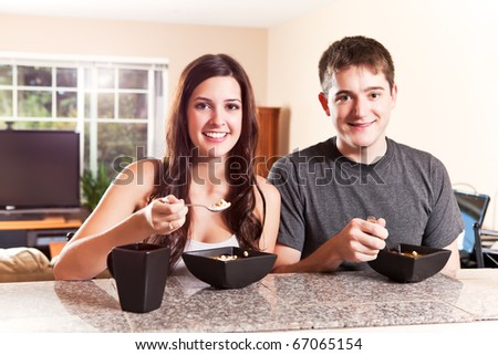 A shot of a young couple eating breakfast - stock photo