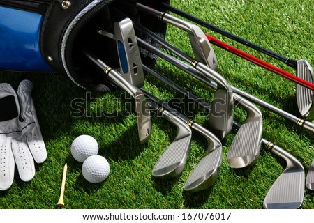 A shot of Golf clubs,balls,tee and glove - stock photo