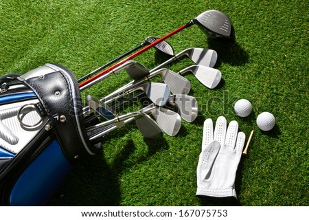 A shot of Golf glove,balls,tee and clubs in bag - stock photo