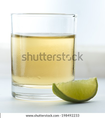 A shot of scotch with lime - stock photo