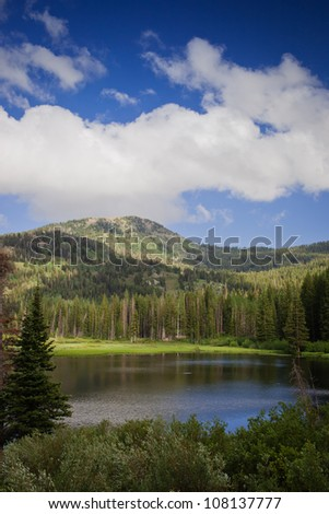 A shot of  Silver Lake with a blue cloudy sky. - stock photo