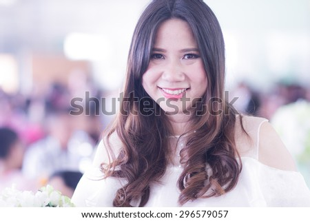 A shot of smiling confident Asian Thai woman in party - stock photo