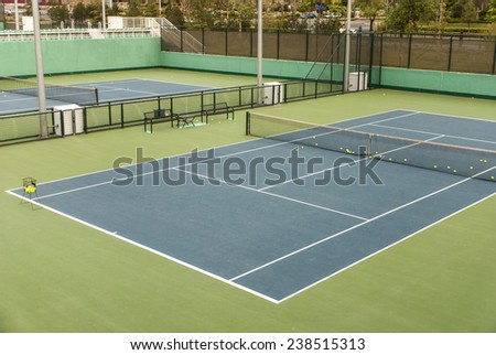 a shot of tennis courts with nobody - stock photo