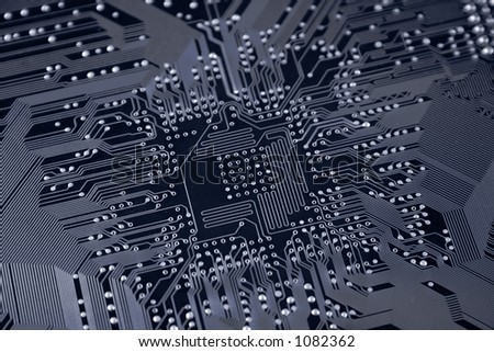 A shot of the back side of a new computer mother board.  This image is a nice background image for print material related to computer technology. (shallow DOF) - stock photo