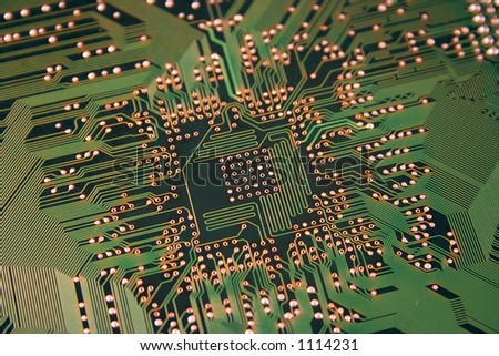 A shot of the back side of a new computer mother board.  This image is a nice background image for print material related to computer technology. - stock photo