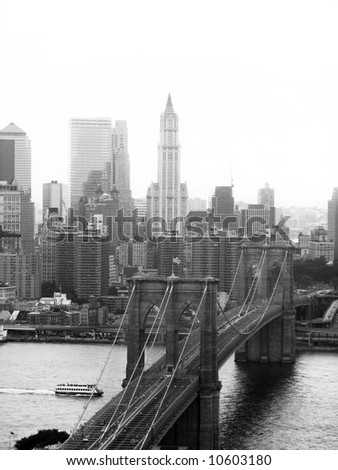 A shot of the Brooklyn bridge in New York City - black and white. - stock photo