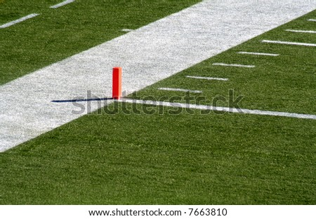 A shot of the endzone showing the goal line and the orange marker. - stock photo
