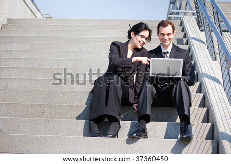 A shot of two business people having a discussion outdoor - stock photo