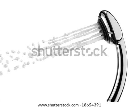 A shower head is spraying water. - stock photo