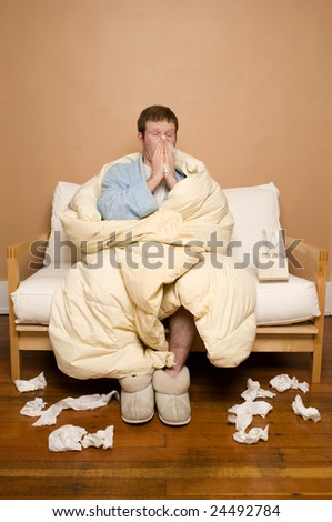 A sick man sneezing - stock photo