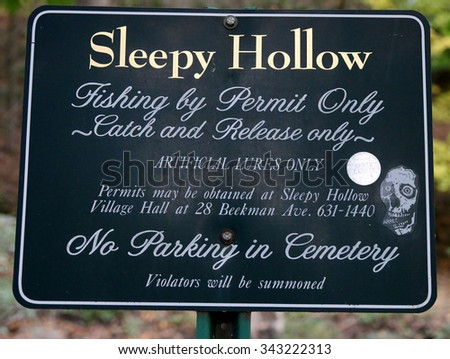 A Sign at the Sleepy Hollow Cemetery Directing Fishermen that a Permit is Needed - stock photo