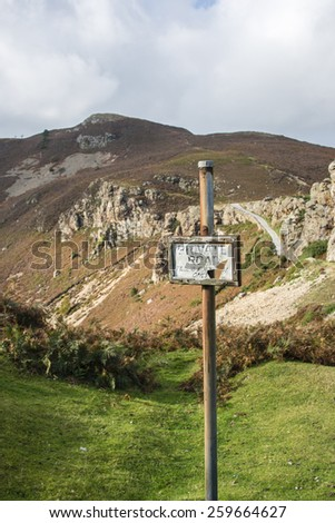 A sign in front of a mountain  near Conwy, North Wales - stock photo
