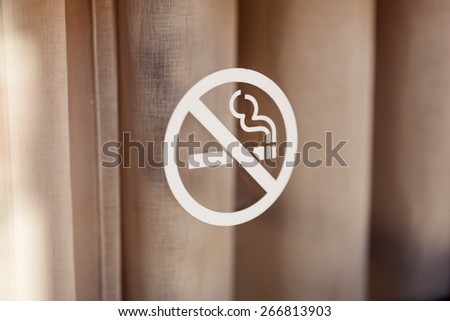 A sign(mark) of no-smoking(non smoking, to stop of smoking) on the vintage(old) glass door - stock photo