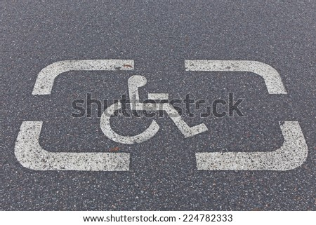 A sign marking a reserved handicapped parking space - stock photo