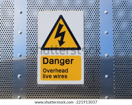 A sign showing danger overhead wires  / Danger overhead wires sign - stock photo