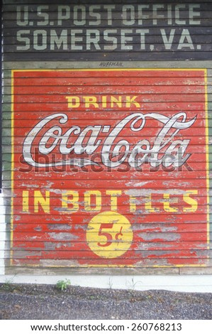 "A sign that reads for ""?Drink Coca-Cola in Bottles 5c,"" Vintage, Somerset, VA. - stock photo"