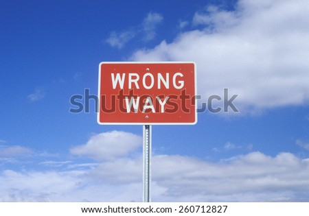 "A sign that reads ""Wrong Way"", do not enter Interstate Highway - stock photo"