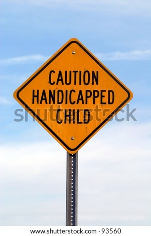 A sign warning drivers of a handicapped child in the area. - stock photo