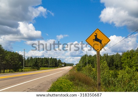 A sign warning people that Deer may run across the road - stock photo
